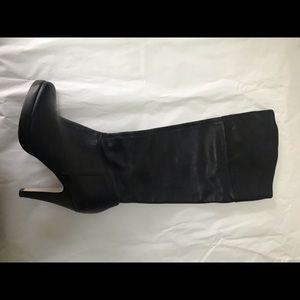 Tall platform black leather boot.